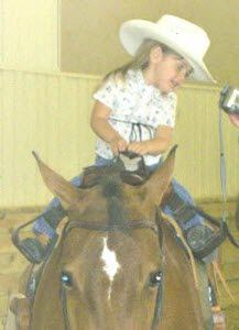 Buddy Stirrups slip over the saddle horn; stirrups can be shortened for small child