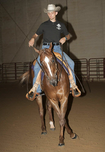 Western riding in the indoor arena; up is Luke Williams, Class of 2016